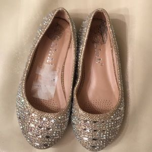 Gold sparkly ballet slippers